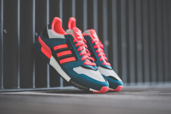 7314b0c55bc7 In Stores Now  adidas ZX 630 – Blue – Red Zest